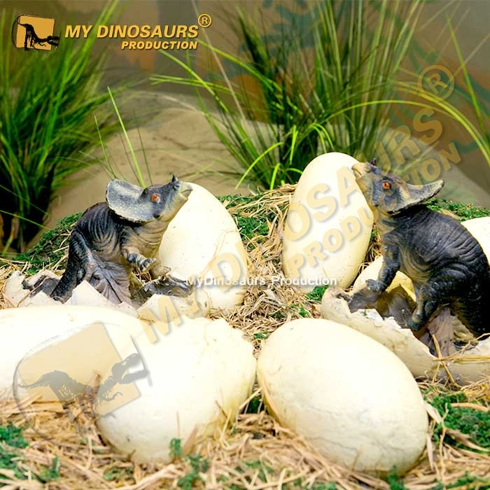 Animatronic baby dinosaur in nest