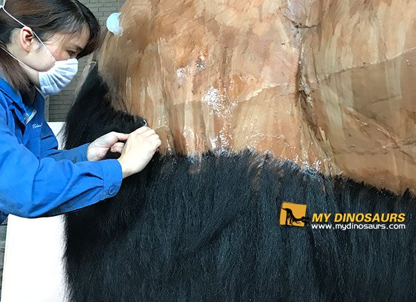 Consider our ice age animatronic animals will be exhibit indoor and the main visitors are kids and families, our technicians plant disinfection treatment hair to mammoth piece by piece, stick different thickness and length hair to the different parts of the mammoth body.