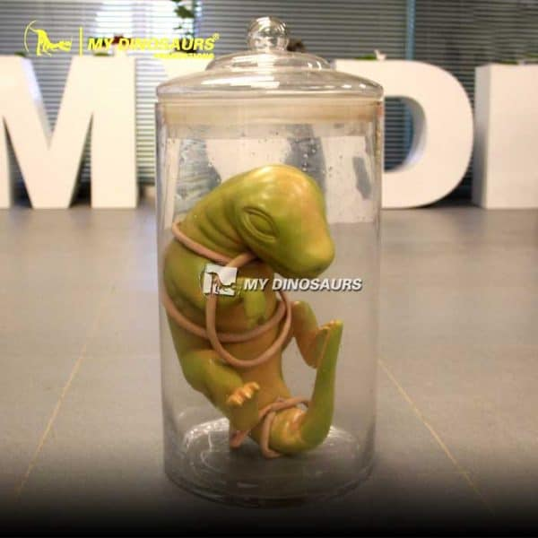 Baby dino in glass jar 1
